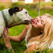 Girl with a dog on the grass — Stock Photo #6220204