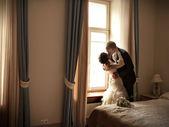 Happy couple in hotel — Stock Photo