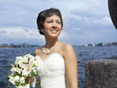 Bride on the waterfront — Stock Photo
