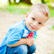 Happy little boy in the park - Stock Photo
