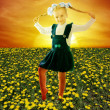 Girl in field of dandelion — Stock Photo
