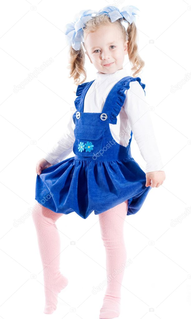 Young girl in blue dress and bow. isolated on white — Stock Photo #6733423