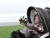 Laughing baby in a stroller — Stockfoto
