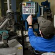 Man with disability operated an industrial machine — Stock Photo