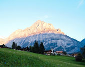 Swiss village view with Jungfrau background — Stock Photo