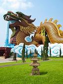 A Big Crouching dragon and small Pagoda — Stok fotoğraf