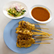 grilled pork satay with peanut sauce and vinegar — Stock Photo