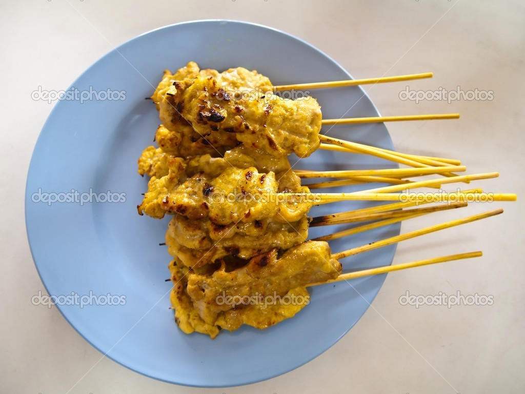 Traditional Thai style grilled pork Satay on plate - Asian food — Stock Photo #5560634