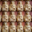 Small Buddha Statue in Rows — Stock Photo