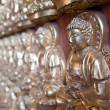 Rows of small Buddha on the wall — Stock Photo