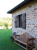 Wooden bench & Chair at House in a garden — Stockfoto