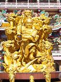 Goddess Naja beating the dragon and china temple Chonburi Thaila — Stock Photo