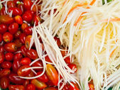 Many Slice papaya and small Tomato — Stock Photo