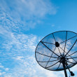 A Satellite communication disk on blue sky background - Stock Photo
