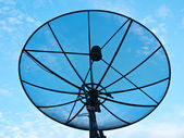 Big Black Satellite Dish on office building on blue sky — Stock Photo