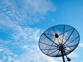 A Satellite communication disk on blue sky background — Stock Photo