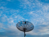 Satellite dish on a blue sky background on Middle — Stock Photo