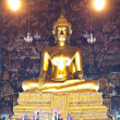 The golden buddha at Wat Suthat Bangkok , Thailand - Stock Photo