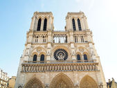 The facade of Notre Dame in Paris , France — Stock Photo