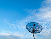 Satellite communication disk on blue sky background — Stock Photo
