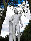 Statue of man hold a grape — Stock Photo