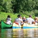 Three canoe boats on river — Stock Photo