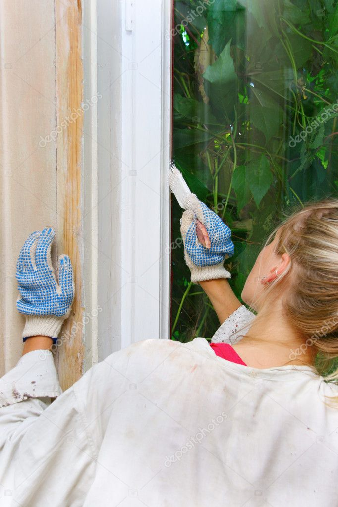 Woman restores the window frame color — Stock Photo #6290211