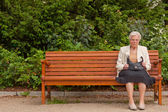 The old woman in the park — Stock Photo