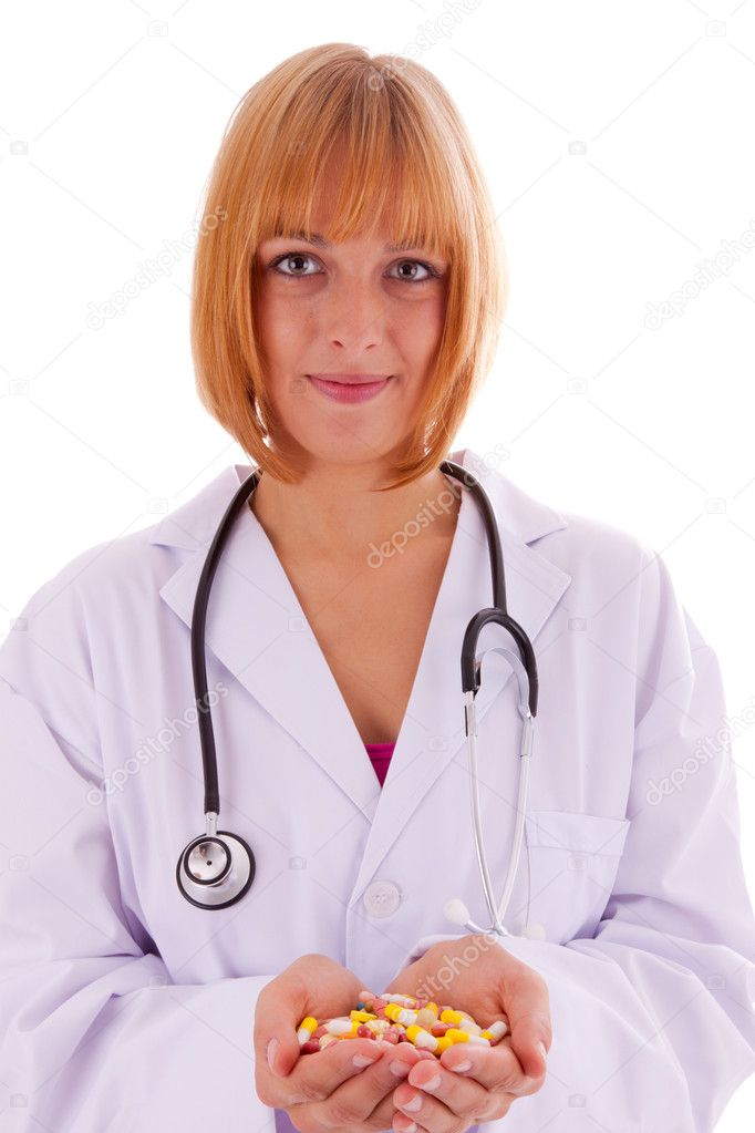 The young doctor with a hand full of pills  Stock Photo #6174369