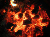 Decaying red coals — Stock Photo