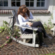 Horse woman in an outdoor chair sensual with boots and white shi — Foto de Stock