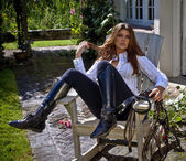 Horse woman in an outdoor chair sensual with boots and white shi — Stock Photo