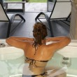 Young woman relaxing in modern hotel spa — Stock Photo