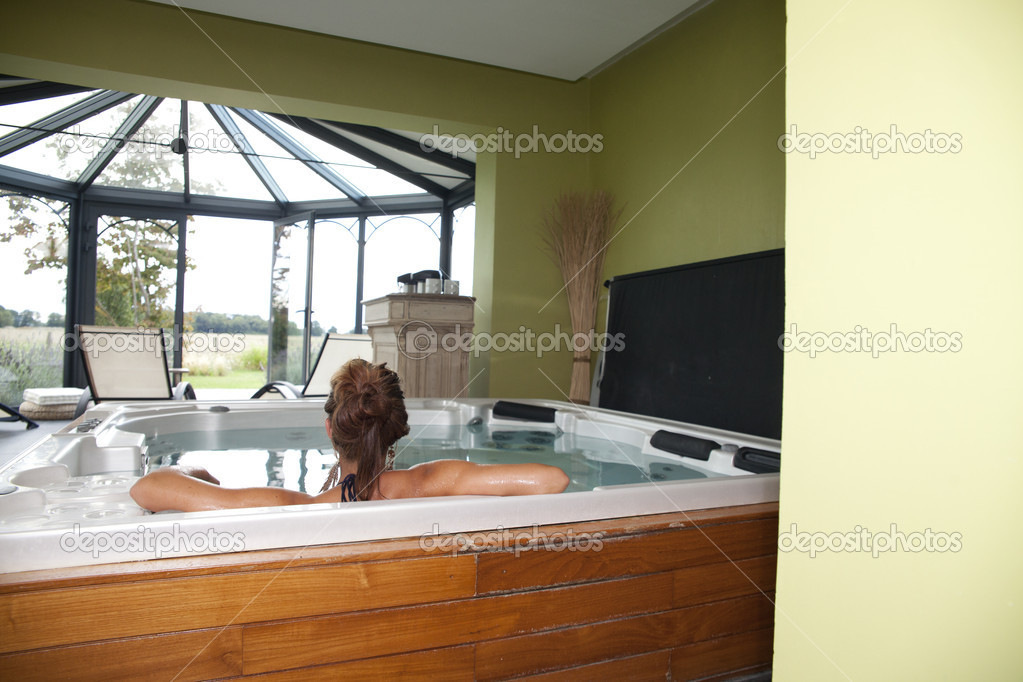 Young woman relaxing in water on modern spa — Stock Photo #6730889