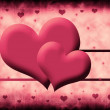 Two hearts on a pink background — Stock Photo