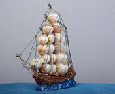 Sailboat with sails of sea shells — Stock Photo