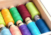 Colorful sewing threads in a box — Stock Photo