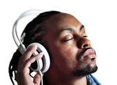 Male listening to headphones with eyes closed — Stock Photo