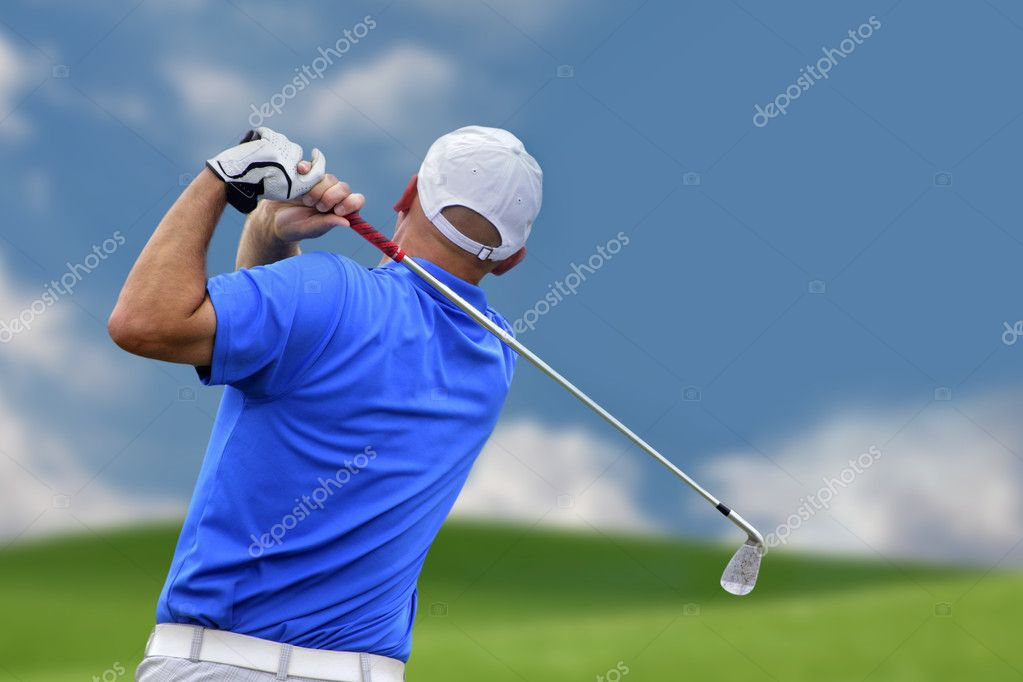 Golfer shooting a golf ball   Foto Stock #5899662