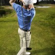 Golfer shooting a golf ball — 图库照片 #5957131