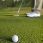 Golfer putting, selective focus on golf ball — Stock Photo