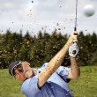 Golfer shooting a golf ball — ストック写真