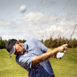Golfer shooting a golf ball — Stock Photo #5957355