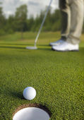 Golfer putting, selective focus on golf ball — Stock Photo