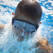 Detail of young man swimming — Stock Photo