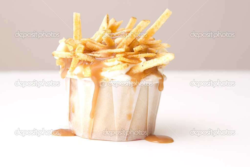 Cupcake in a white paper cup decorated to look like a poutine  Stock Photo #5768519
