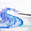 Artist paints — Stock Photo