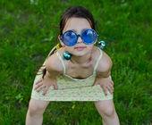 Little girl in funny glasses — Stock Photo