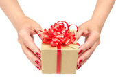 Female hands holding gift box — Stock Photo