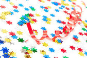 Red party decoration and confetti isolated on white background — Stock Photo
